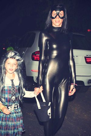 Liberty Ross dresses up as Catwoman while trick-or-treating