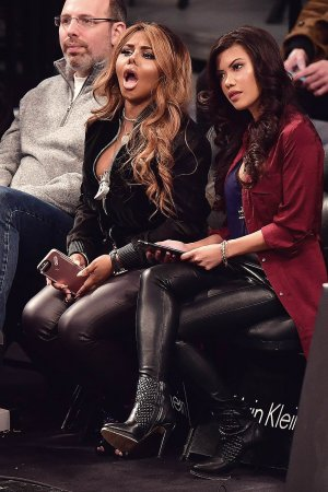 Lil' Kim attends New York Knicks Vs. Brooklyn Nets game