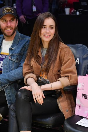 Lily Collins at a Los Angeles Lakers game
