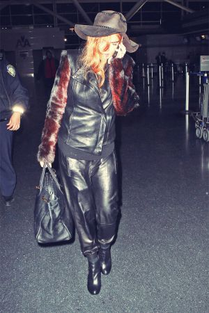 Lindsay Lohan boarded a flight to Los Angeles