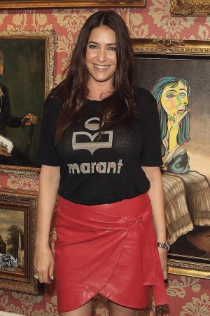 Lisa Snowdon attends Keep Smiling by Mr. Brainwash private view