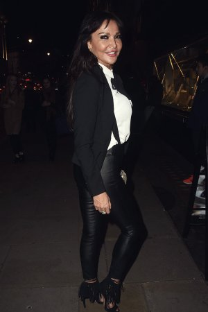 Lizzie Cundy pose for the camera while at the ITV Gala Party