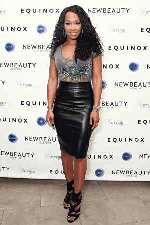 Malika Haqq arrives at the Fall Into Amazing Skin event