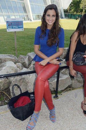 Malika Menard attends the Laure Manaudou Design Swimming Suit show