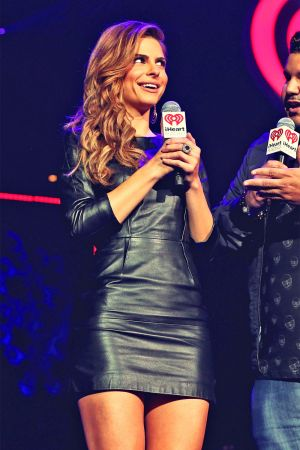 Maria Menounos and Chuey Martinez onstage during KIIS FM's Jingle Ball