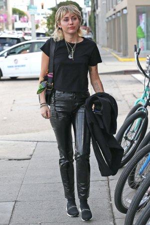 Miley Cyrus arrives at a studio