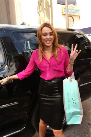 Miley Cyrus at Topshop Store Opening in Chicago