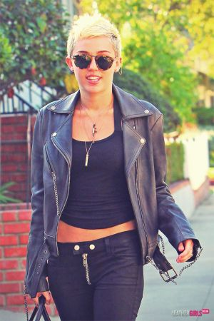 Miley Cyrus rocks a leather jacket and pants