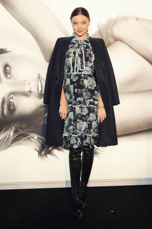 Miranda Kerr poses before she greets fans at Westfield