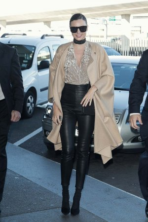 Miranda Kerr seen at Charles-de-Gaulle & LAX airports