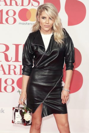 Mollie King attends 38th Brit Awards
