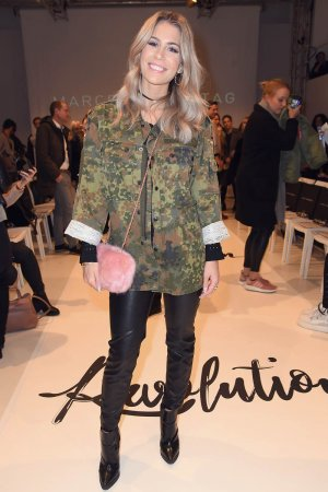 Mrs Bella attends the Marcel Ostertag show