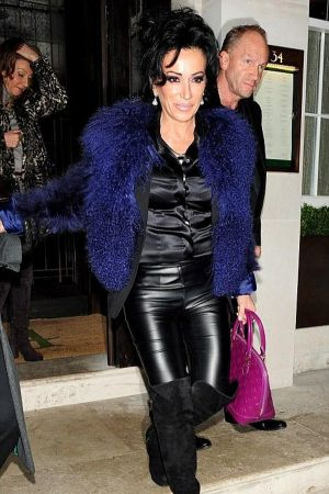 Nancy Dell'olio leaves steakhouse restaurant 34 after a night of dining in Mayfair