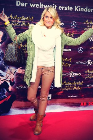 Natalie Langer attends Film Premiere Cinderella and Puss in Boots