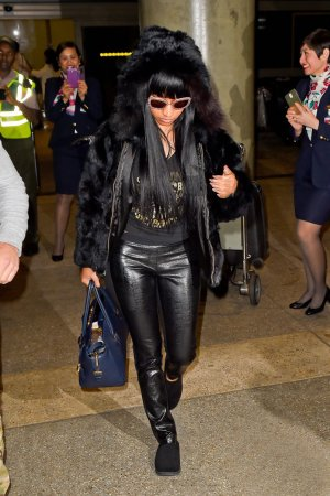 Nicki Minaj arriving on an international flight at LAX Airport