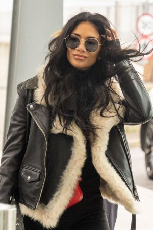 Nicole Scherzinger at Heathrow Airport