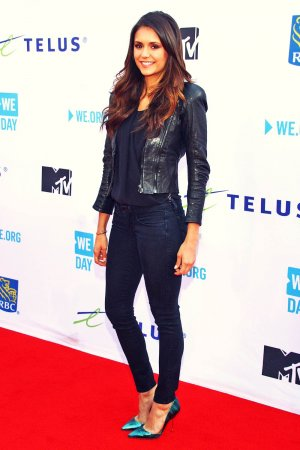 Nina Dobrev attends WE Day Toronto at Air Canada Centre