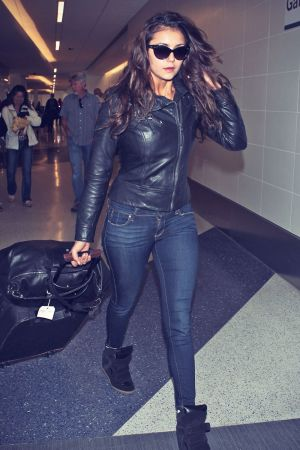 Nina Dobrev catching a flight at LAX airport