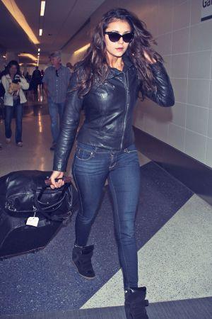 Nina Dobrev catching a flight at LAX airport