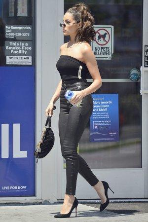 Olivia Culpo pumping gas in LA