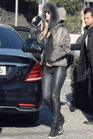 Paris Hilton arrives at her hotel in Milan