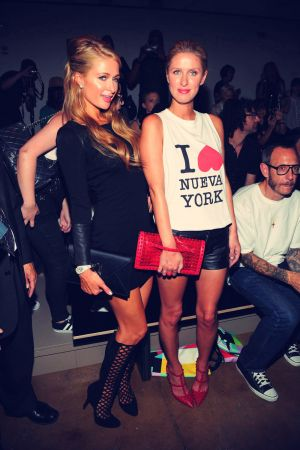 Paris & Nicky Hilton attends Jeremy Scott Show during Spring 2014