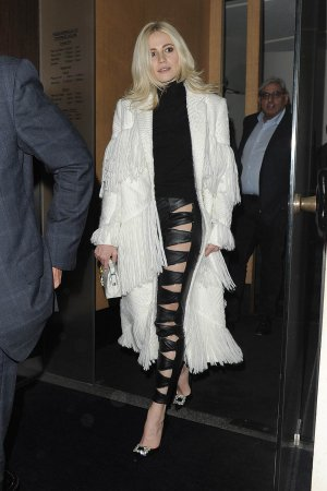 Pixie Lott is seen leaving Nobu Berkeley St restaurant