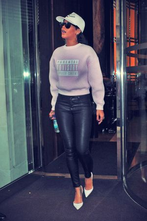 Rihanna leaves her hotel to film a talk show