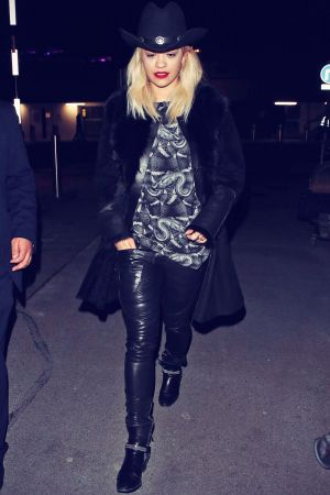 Rita Ora arrives at London Heathrow Airport