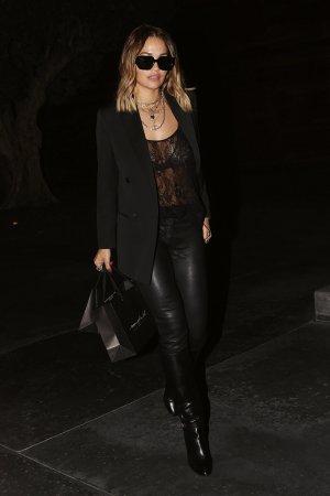 Rita Ora rocks a sheer black top as she enjoys some retail therapy