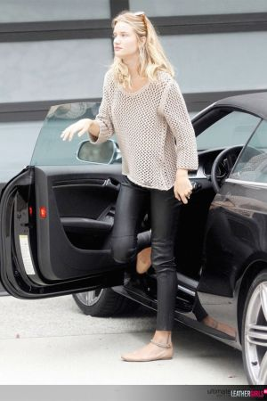 Rosie Huntington-Whiteley arriving home in her black sports car