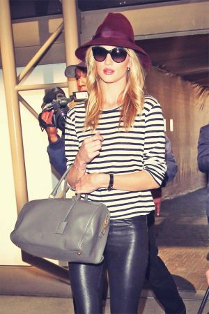 Rosie Huntington-Whiteley is seen at LAX Airport wearing leather leggings