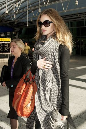 Rosie Huntington-Whitely arriving at London's Heathrow Airport