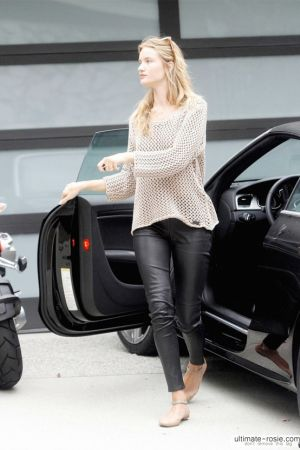 Rosie Huntington-Whitely  arriving home in her black sports car, Los Angeles