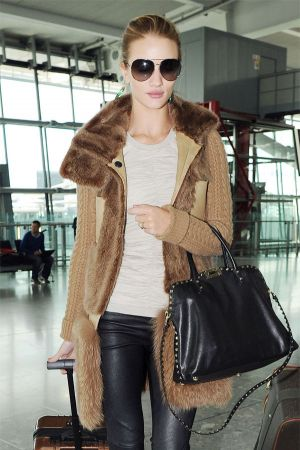 Rosie Huntington-Whitely at Heathrow airport