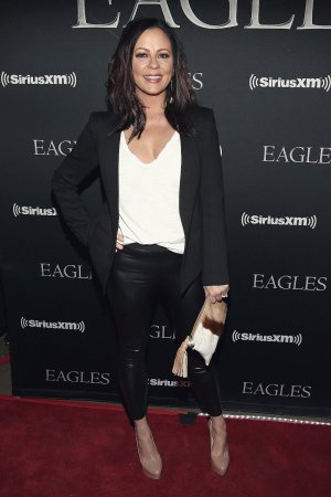 Sara Evans attends the Eagles in concert