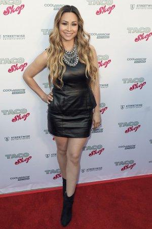 T Lopez attends Premiere of Taco Shop