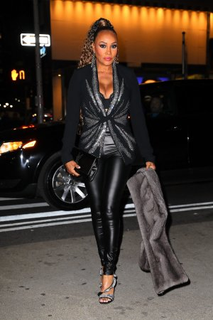 Vivica A Fox leather leggings while arrives at the Ovarian Cancer Research Alliance