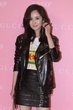Yang Mi attends an opening ceremony of Shin Kong Place flagship store