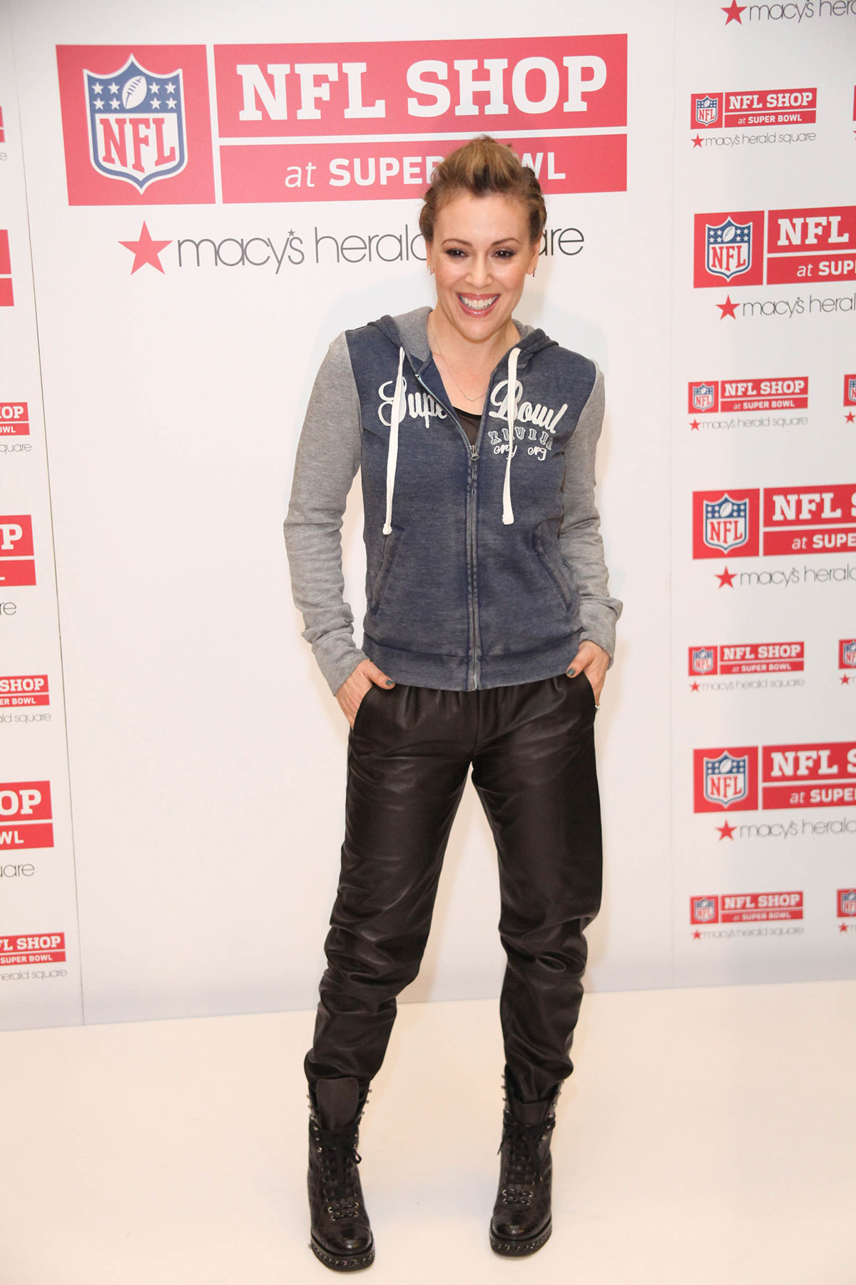 Alyssa Milano attends The NFL Shop event for Super Bowl XLVIII