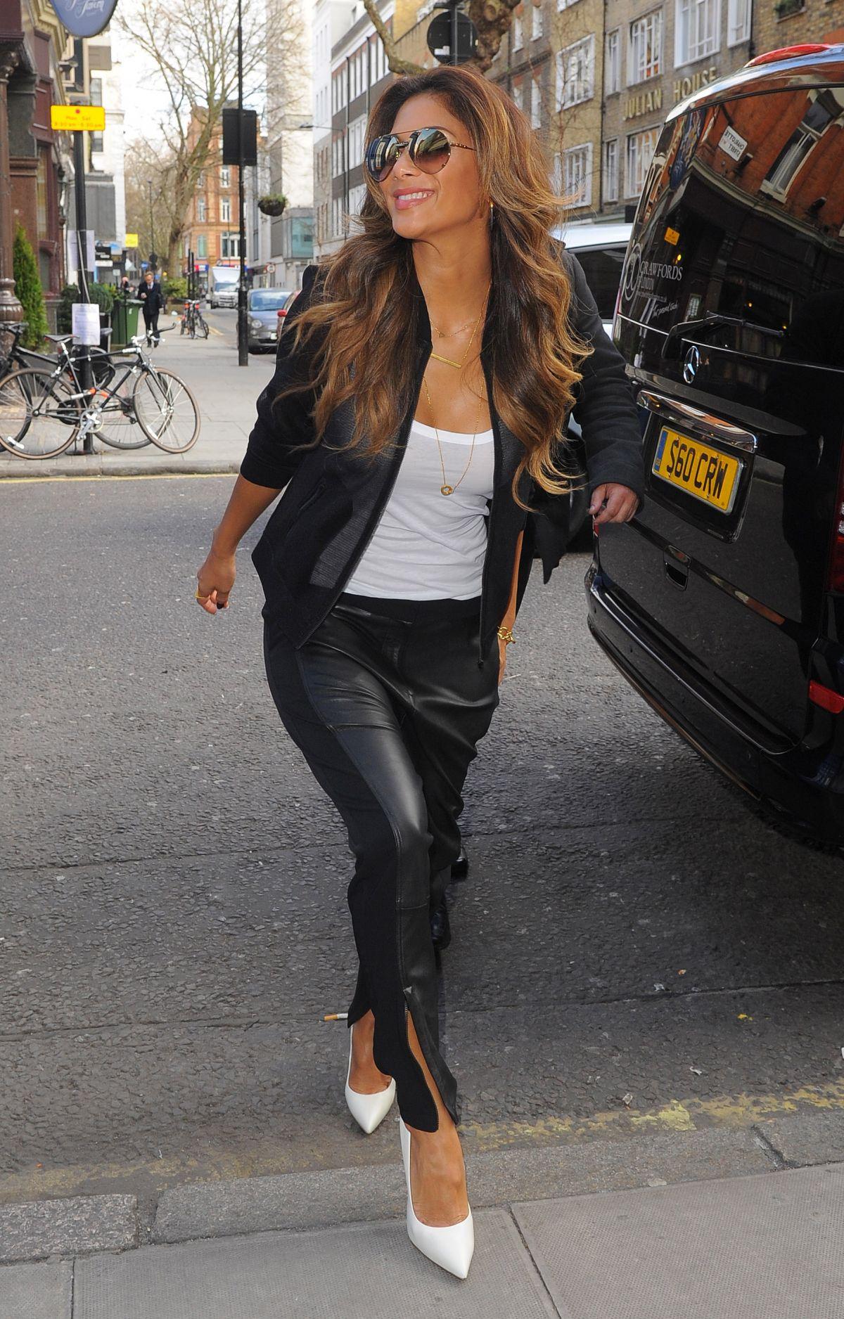 Nicole Scherzinger arrives at an office building
