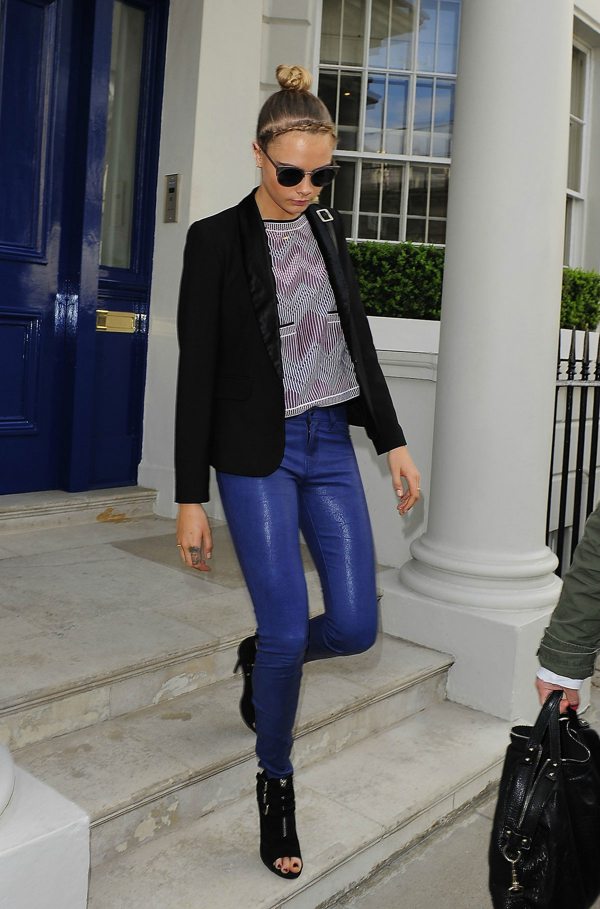 Cara Delevingne seen leaving home and heads to a London hotel