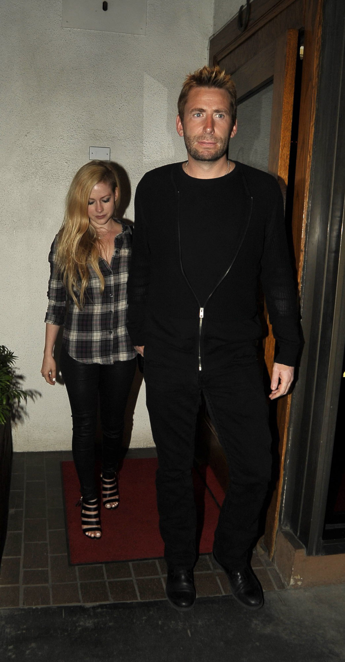 Avril Lavigne leaving Madeo Restaurant
