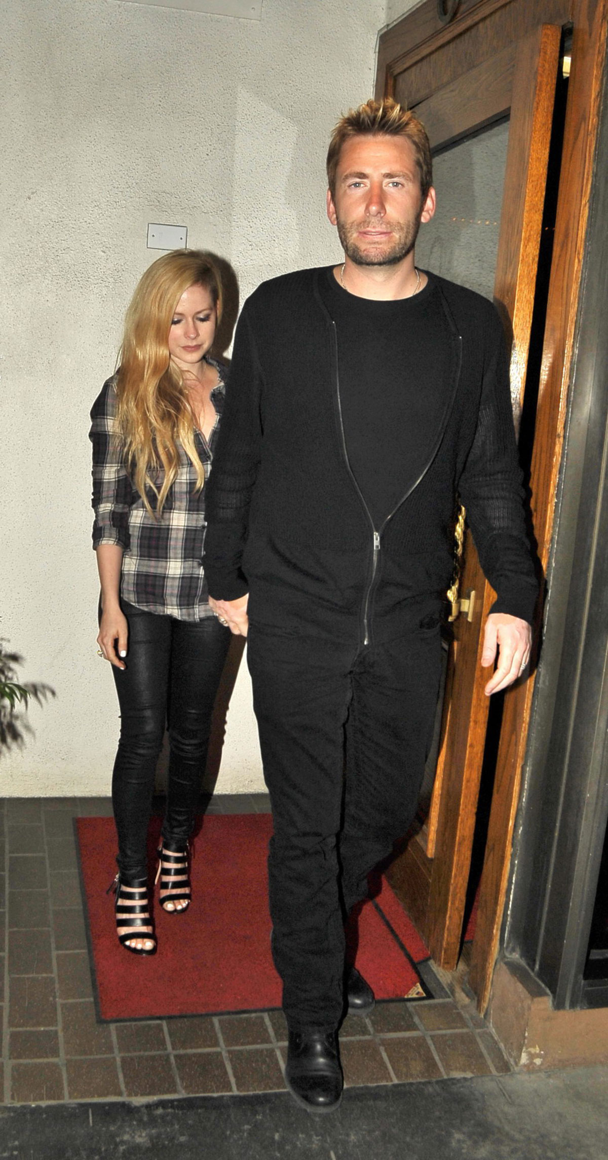 Avril Lavigne leaving Madeo Restaurant