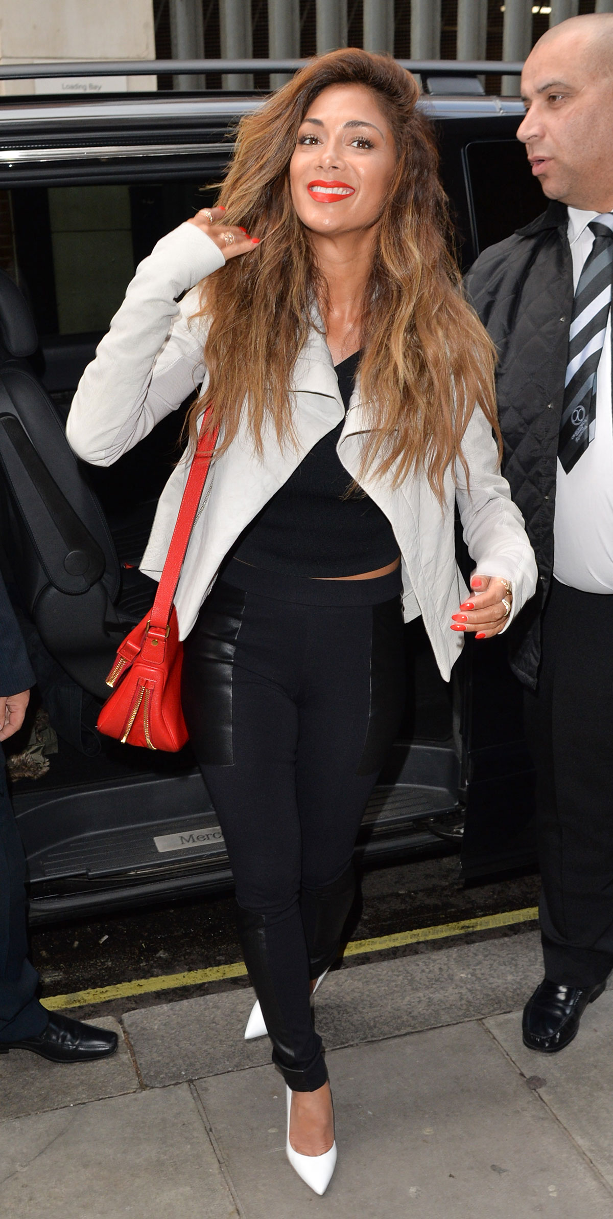 Nicole Scherzinger at KISS FM Radio Station