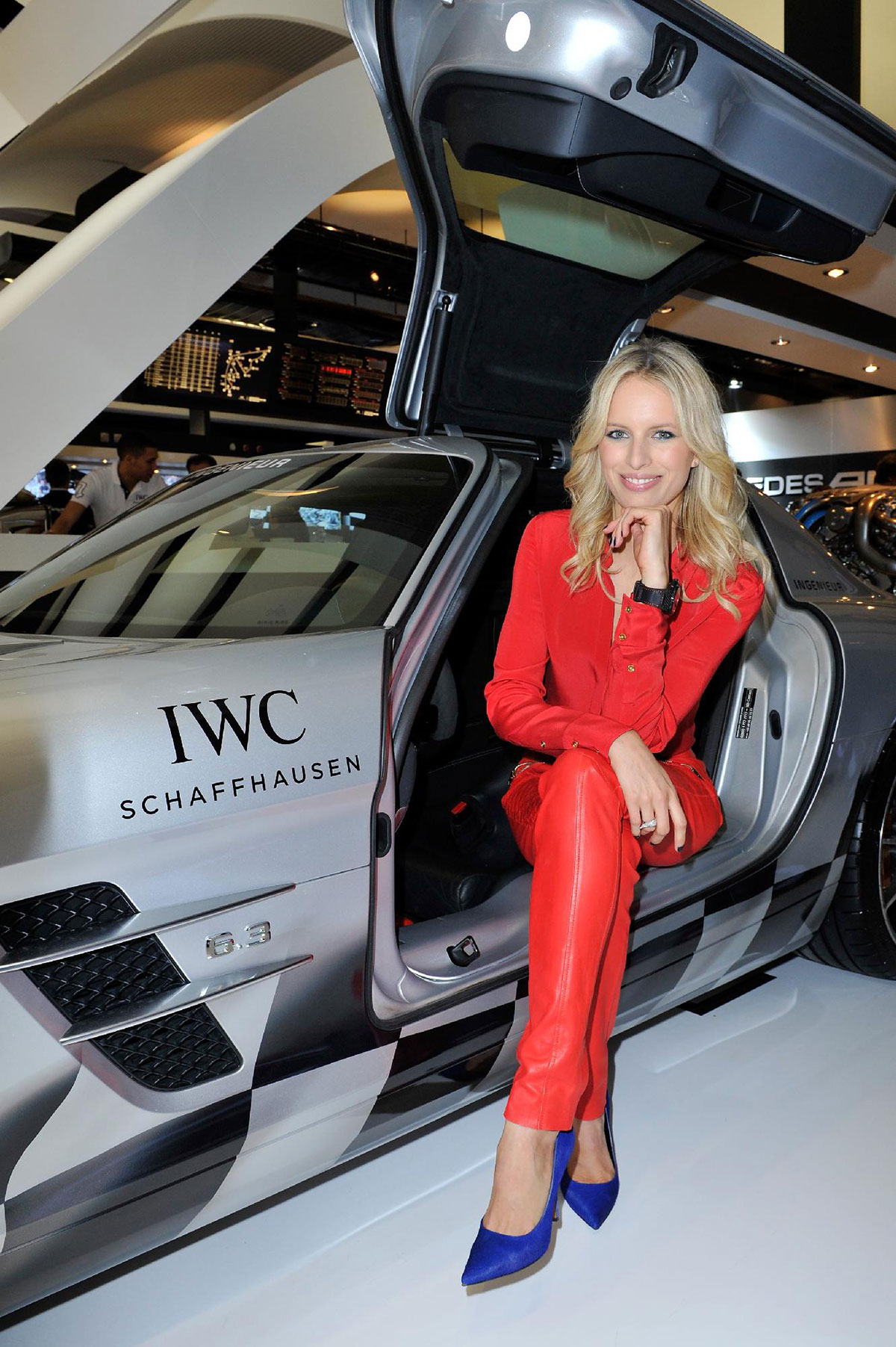 Karolina Kurkova visits the IWC booth during the SIHH