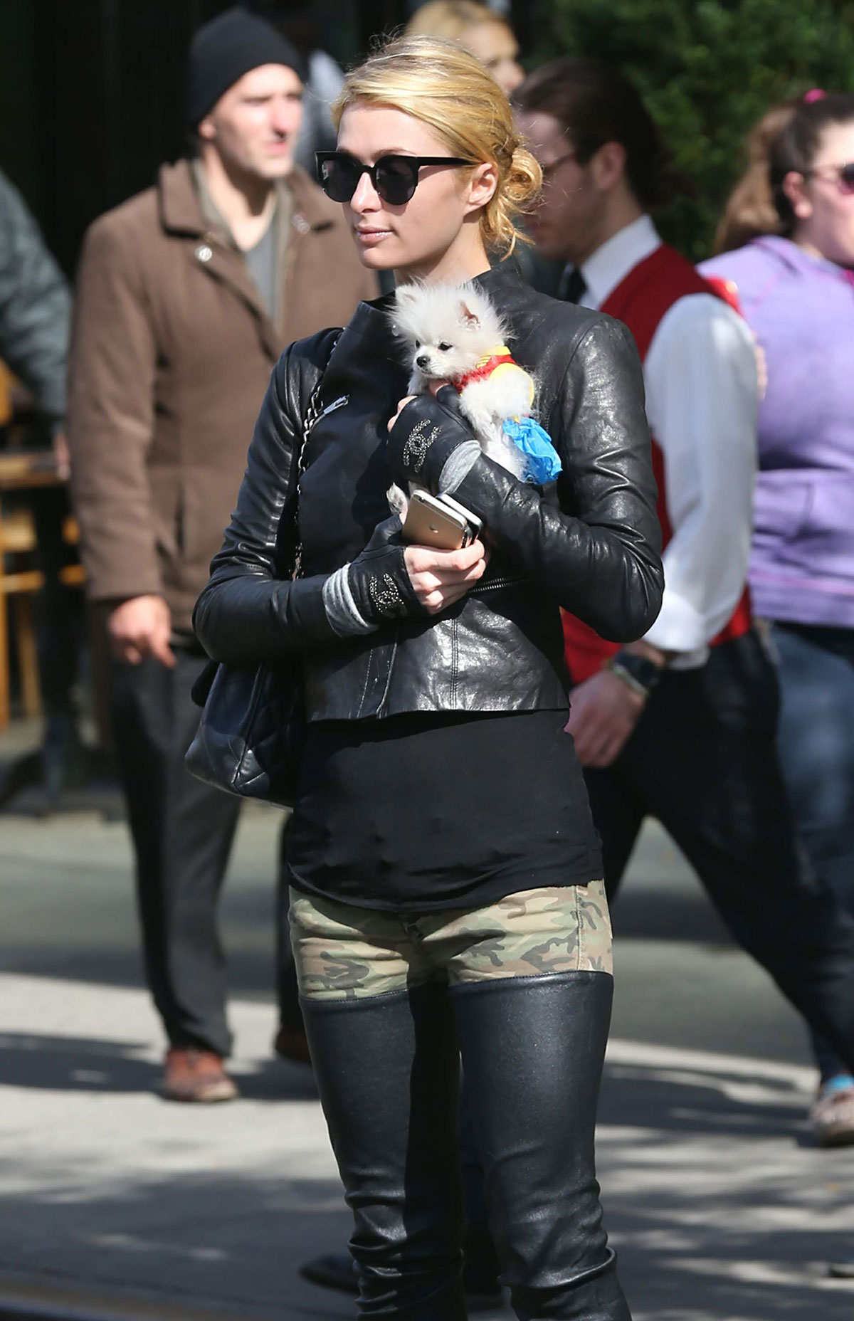 Paris Hilton seen with her dog waiting for a cab