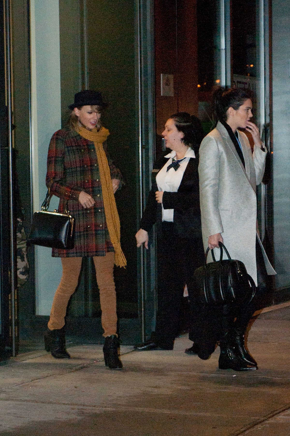 Kendall Jenner, Taylor Swift and Cara Delevingne coming out of Gigi Hadids house