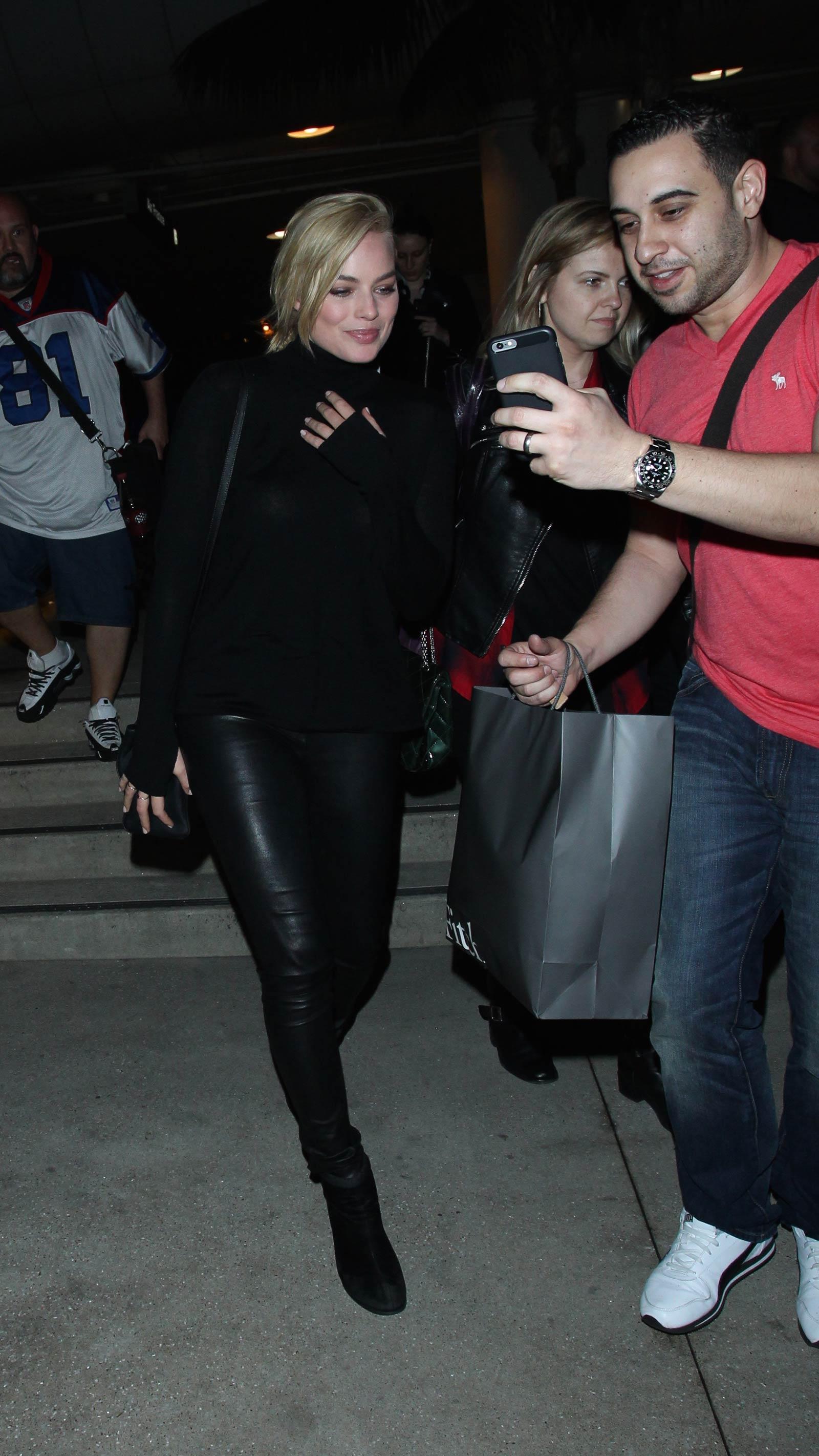 Margot Robbie LAX departure candids in Los Angeles