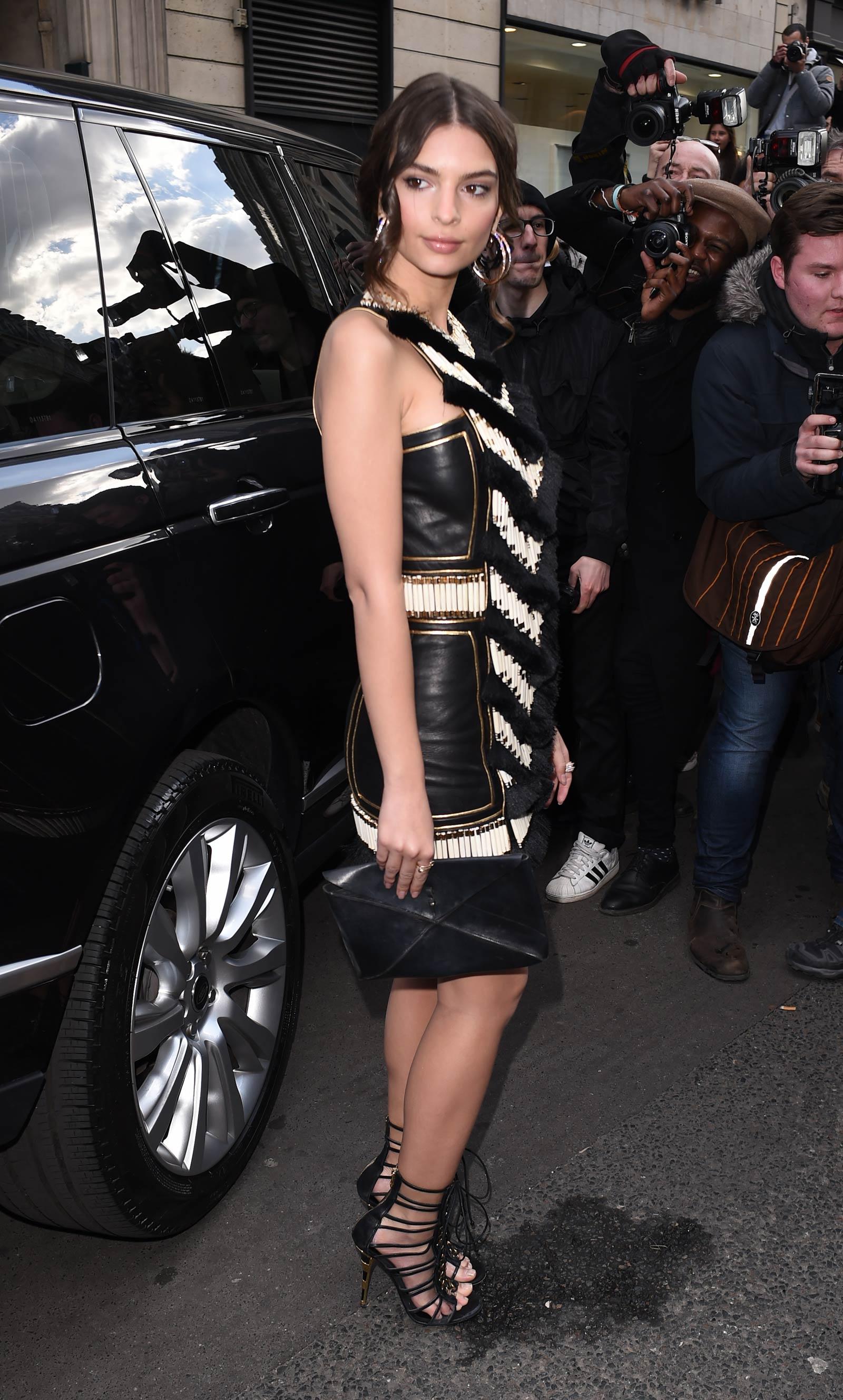 Emily Ratajkowski attends Balmain show during Paris Fashion Week